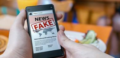 man-is-holding-smartphone-and-reading-fake-news-on-internet-propaganda-disinformation-and-hoax-concept-1523260310658_v2_615x300